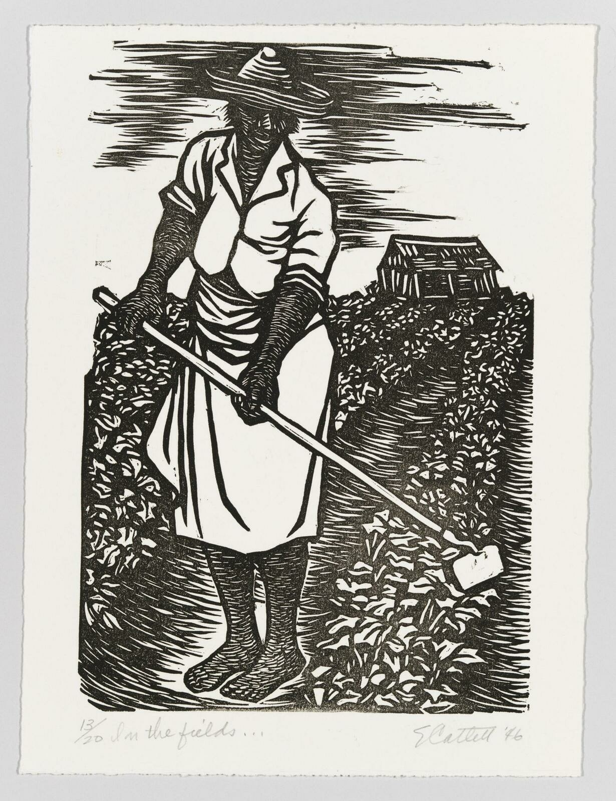 A Black woman wearing a simple white dress and straw hat using a hoe in a sprawling field with a small house visible in the background