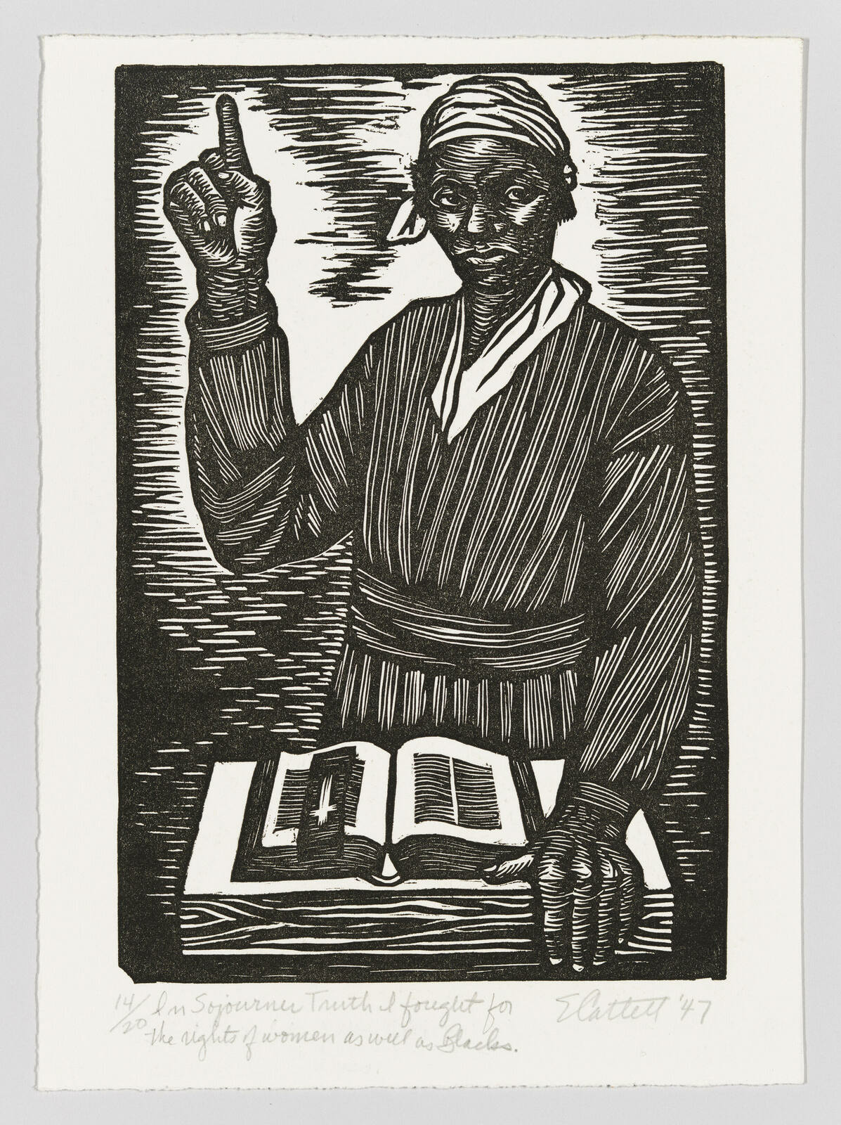 Sojourner Truth pointing upwards with her right hand and holding a table containing a bible with her left.