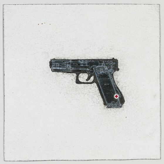Centered on a white background, a black handgun with a small red cross on the lower grip