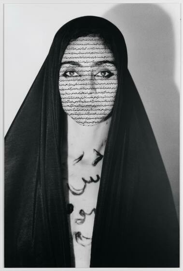 An Iranian woman in an open, vertical black veil with Farsi text covering her face.
