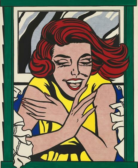 A smiling, red-headed woman leans out a green-paned window