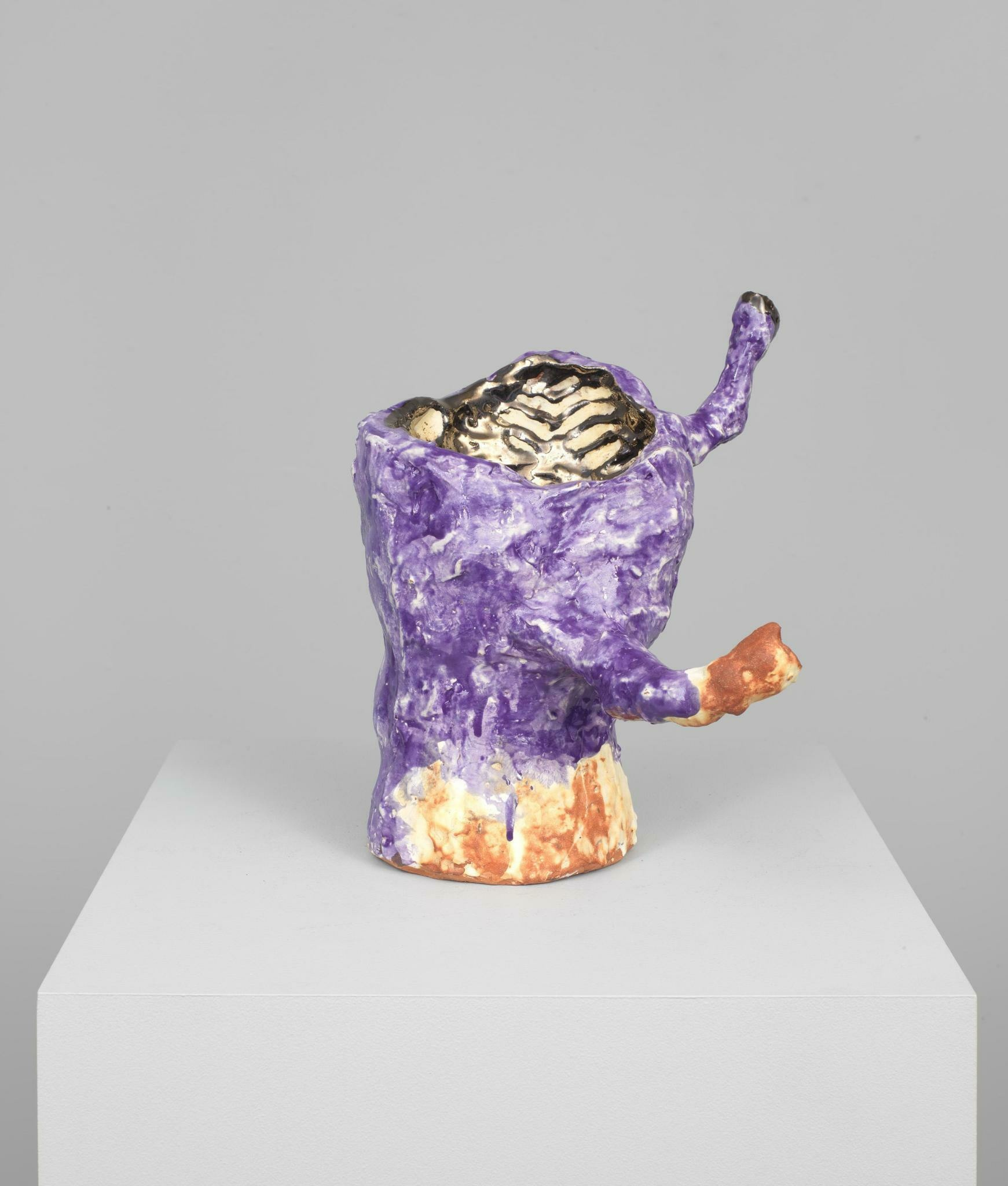 Corporeal red clay sculpture in a roughly finished purple glaze and metallic gold interior with two skinny protruding armatures