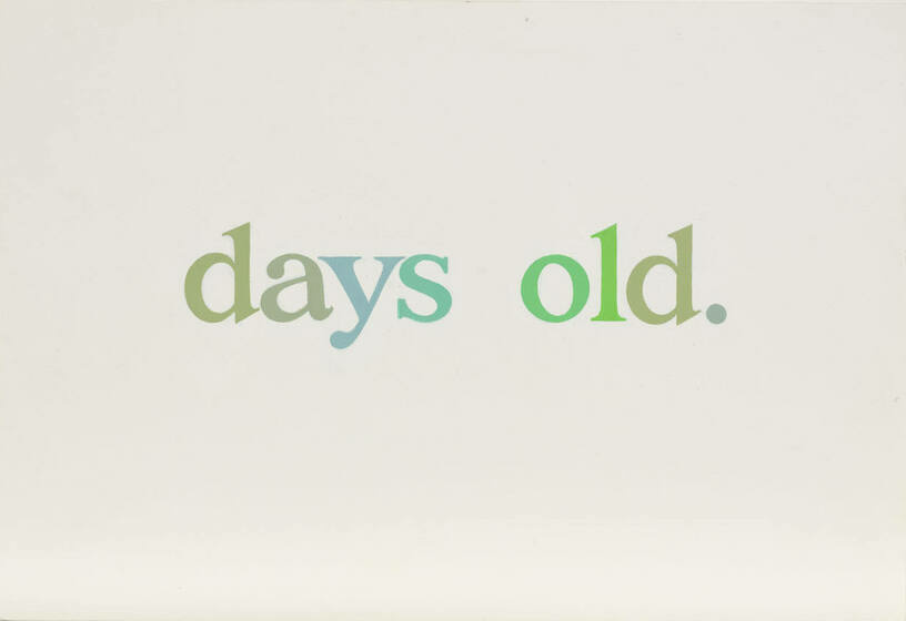 """The phrase """"days old"""" is written in varying green hues aganist a cream background"""