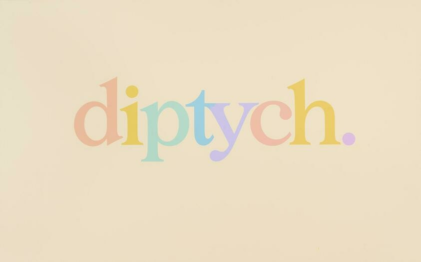 """The word """"diptych"""" is written in pastel color aganist a light yellow background"""
