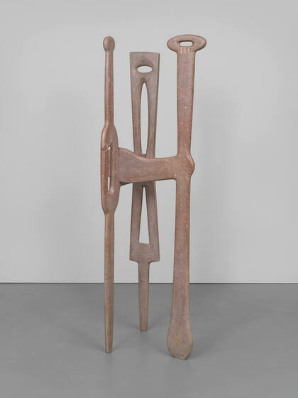 A warm monotone sculpture with an organic tripod formation, smooth and sinewy lines, and varied negative spaces.