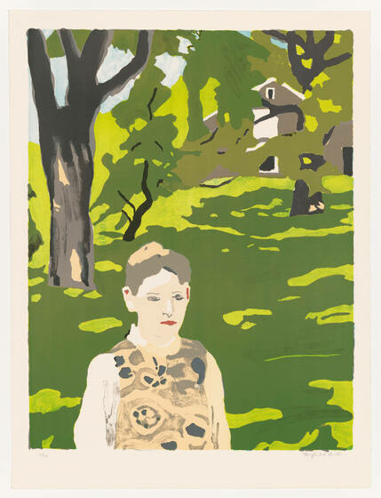 A white girl in a khaki-colored print dress stands on a dark and lime green-colored lawn. The lawn leads to a grayish-brown house that peaks through the trees.