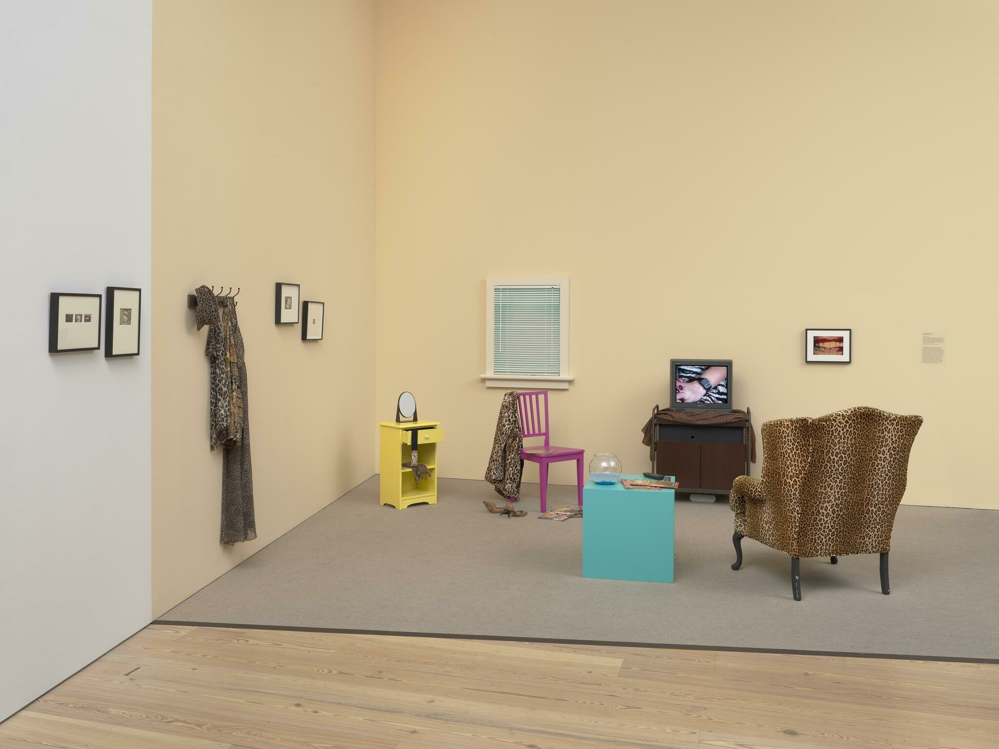 A woman's life plays out on a TV set in the middle of her living room.