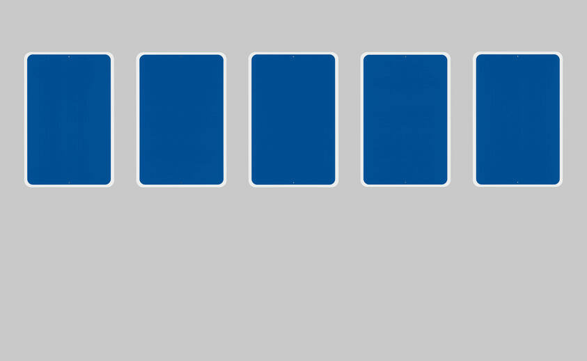 A series of five blank blue rectangular signs each with a thin white border, reminiscent of accessibility signage