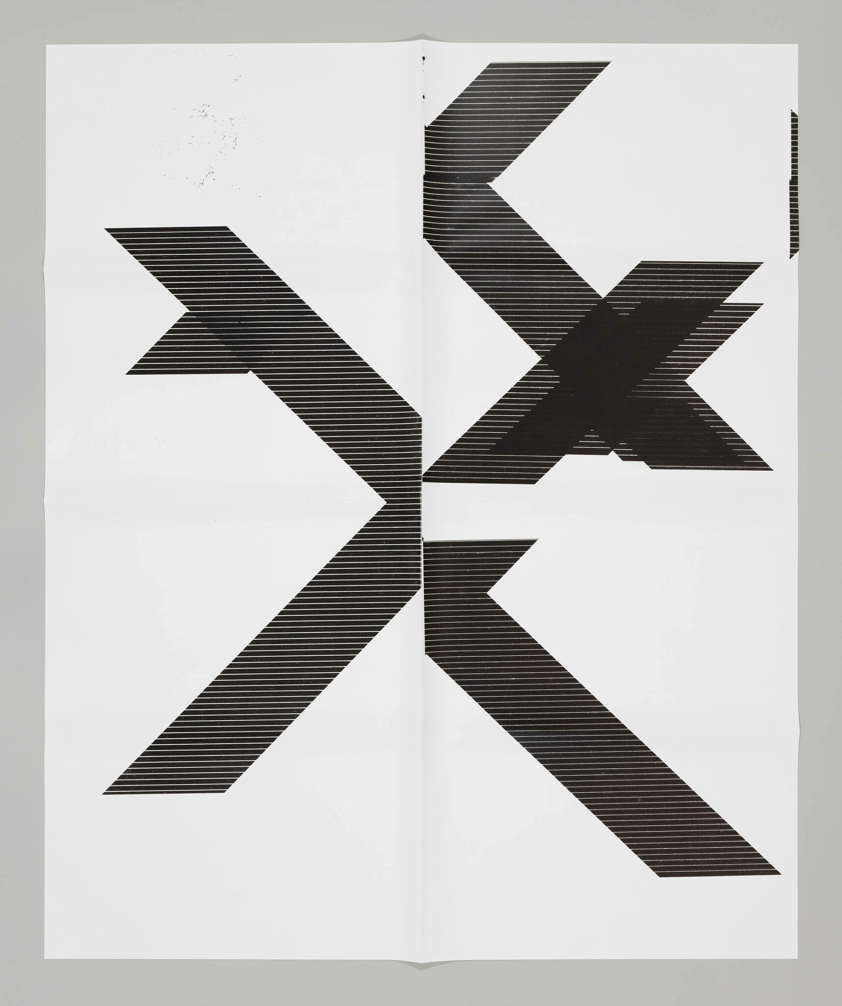 """Fragments of black letters """"X"""" scattered across white background."""