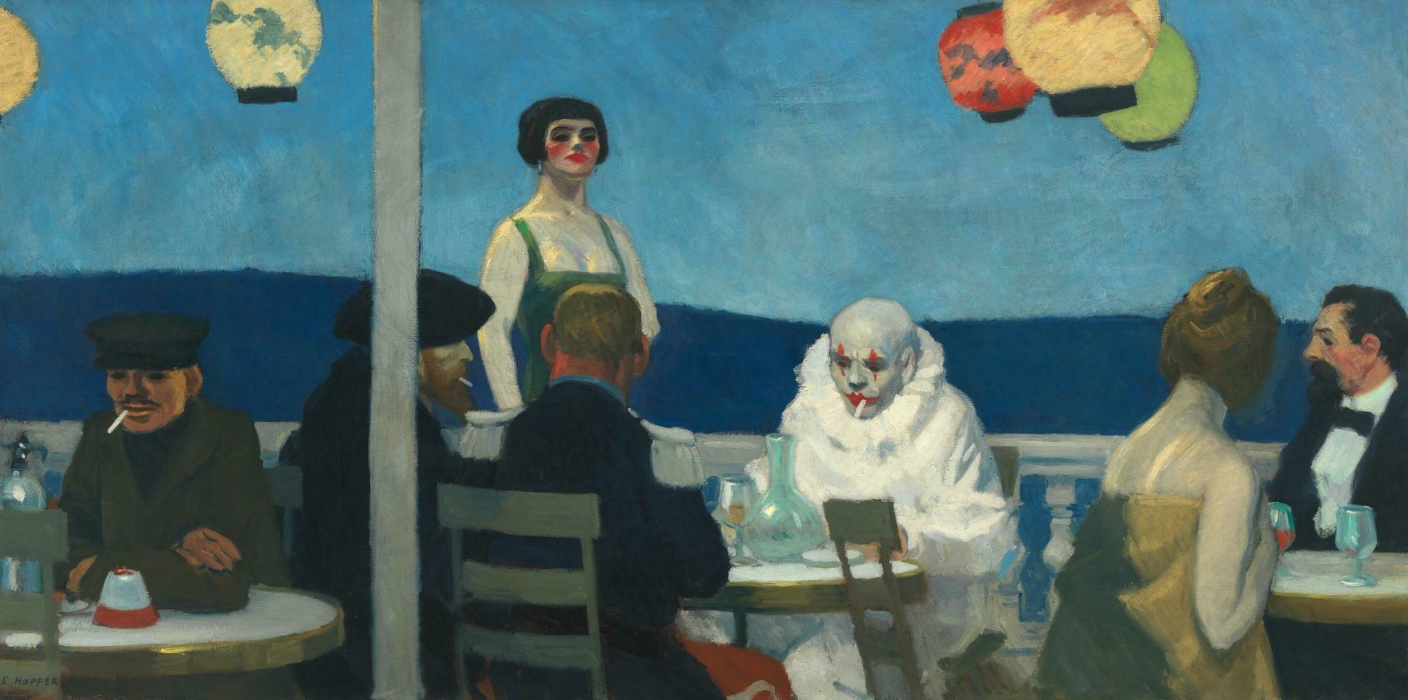 On a balcony, six figures in eclectic attire sit at dining tables and make no eye contact.