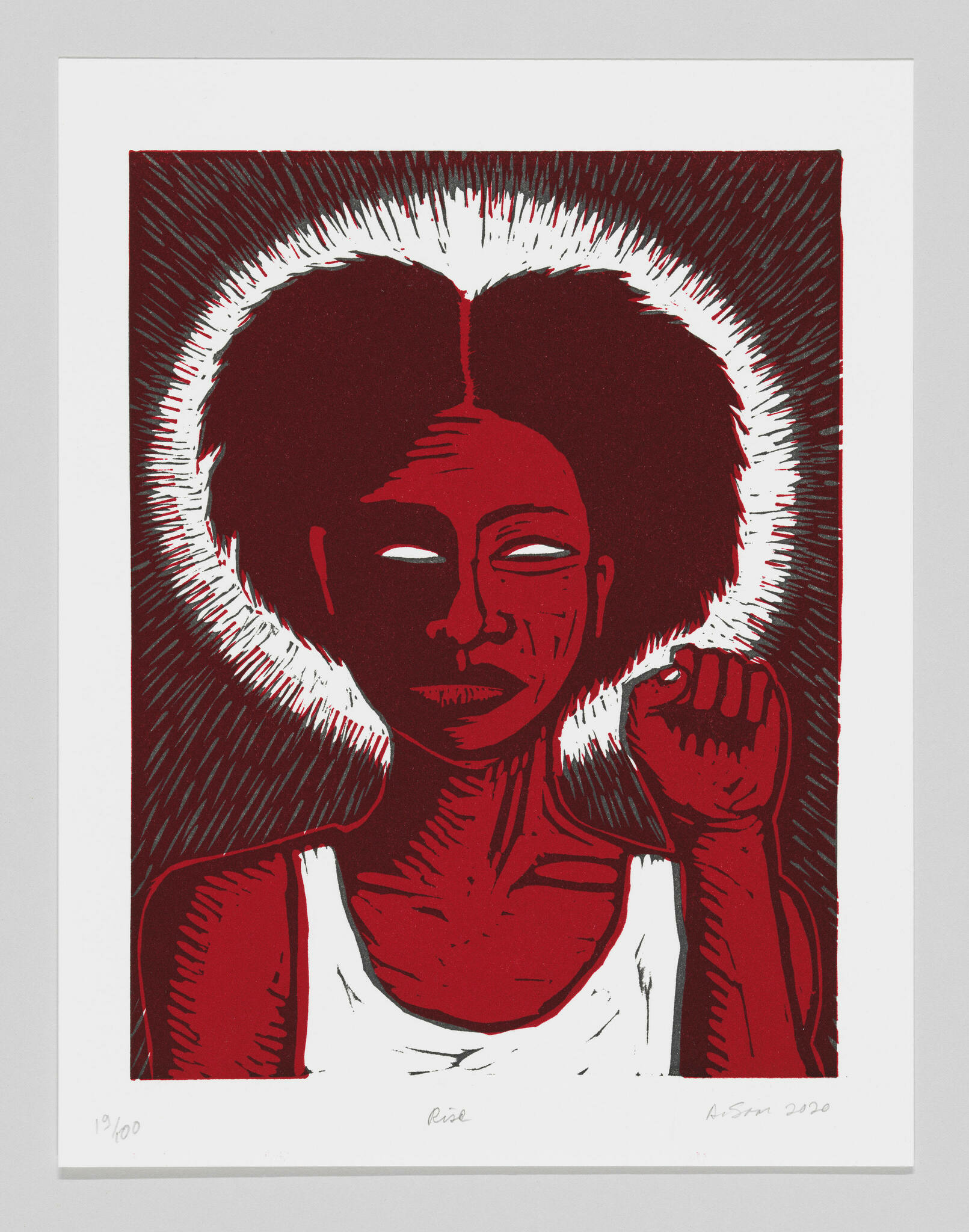 A monochrome red print of a black woman with her left fist up and a white halo.