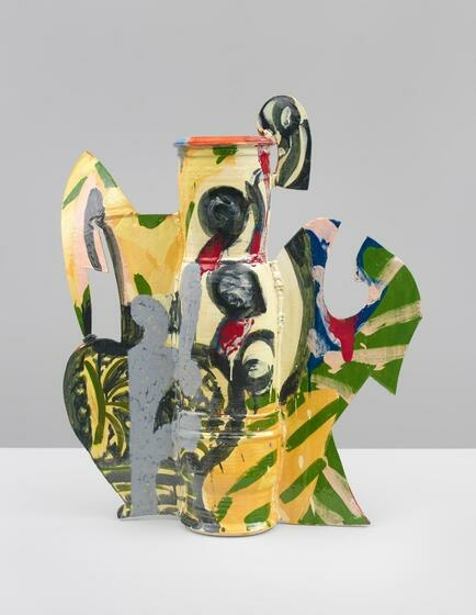 A pitcher-like glazed ceramic with flat, protruding shapes and covered in colorful green, yellow, blue, red, black, and gray brush strokes and patterns.