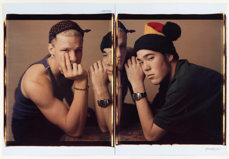 Fractured across a diptych, two short-haired teens in sporty attire look directly at the camera, heads propped on their hands.
