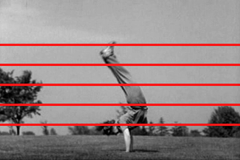 A black and white photo of a man doing a hand stand with red lines running through it.