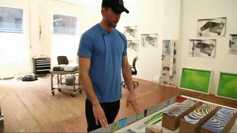 Artist Kelly Walker looks at a model of his art installation.