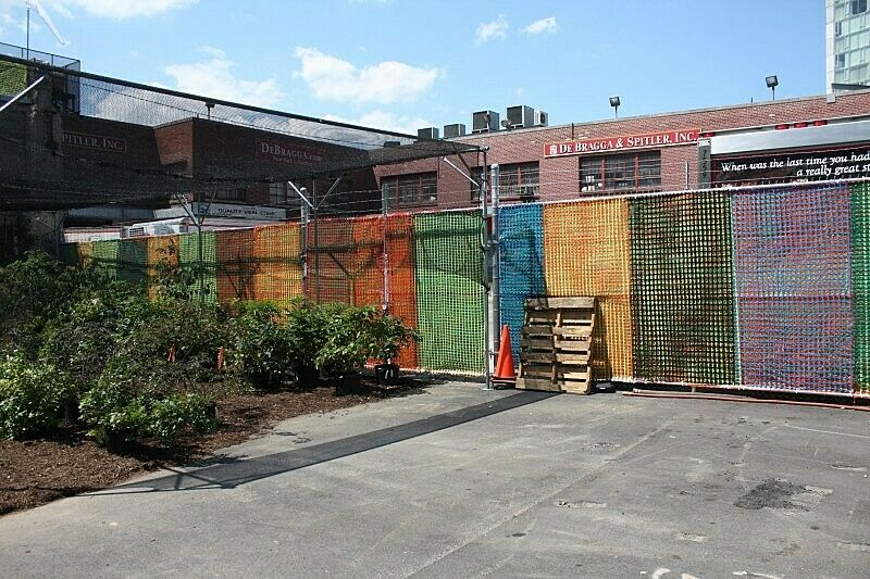 The outdoor site with colorful fences