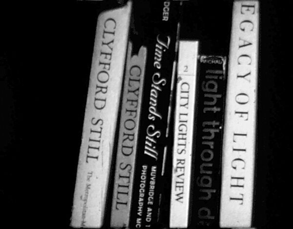 Books in a video still.