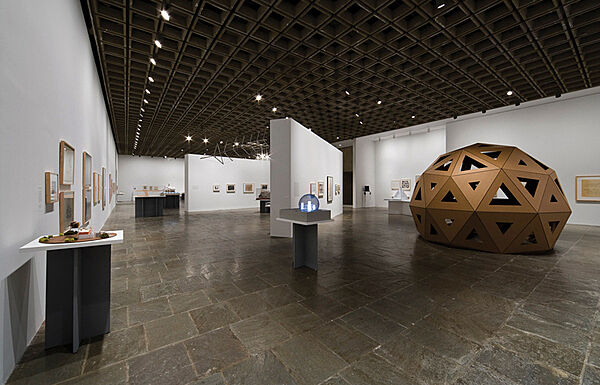 A geodesic dome and architectural  exhibits in a gallery.