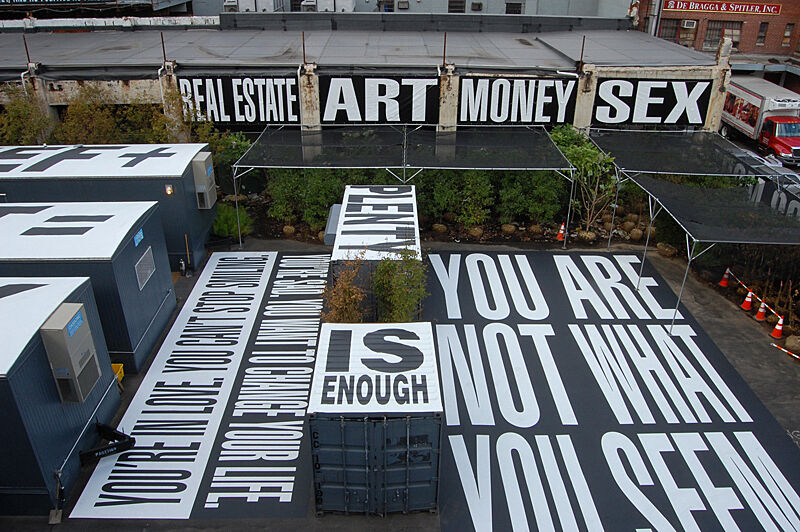 An outdoor art installation with text on a construction site