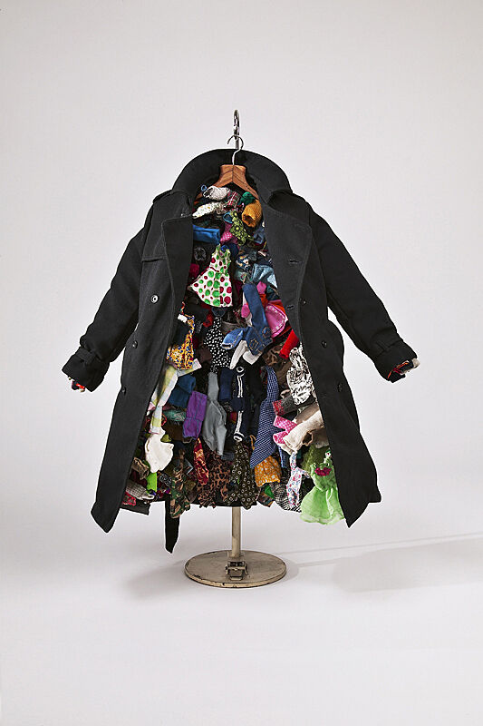 A blue jacket filled with small, colorful dresses.