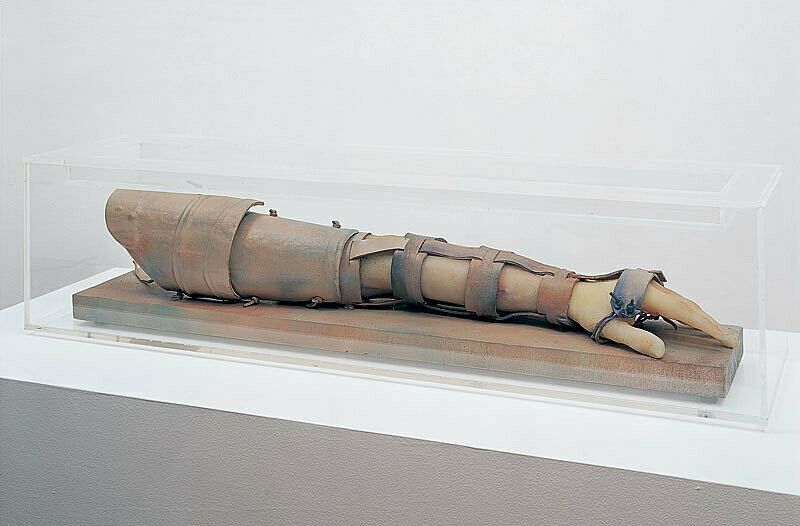 A sculpture of an arm in armor.