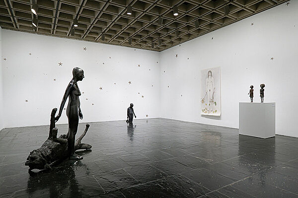 Sculptures and a painting in a gallery.