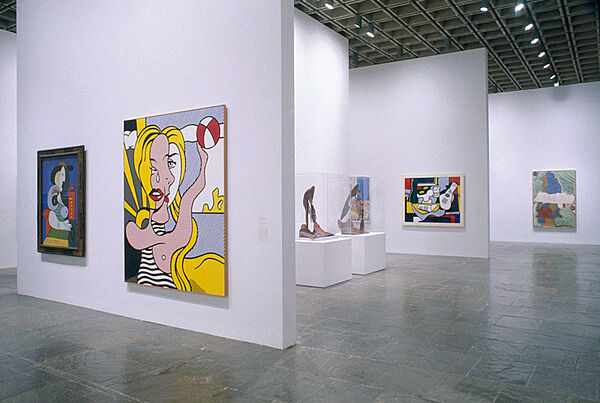 Large paintings by Picasso on the walls of a gallery.