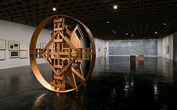 A large circular sculpture in a gallery.