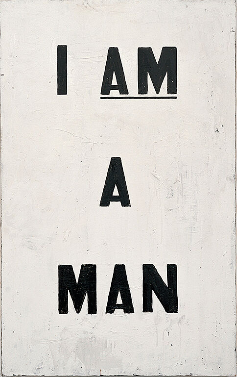 "A painting of text that reads ""I am a man,"" where ""am"" is underlined."