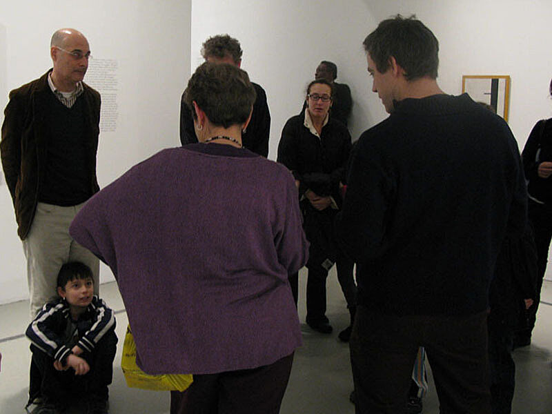 The artists in their exhibition space