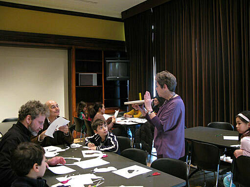 The artist interacts with workshop participants.