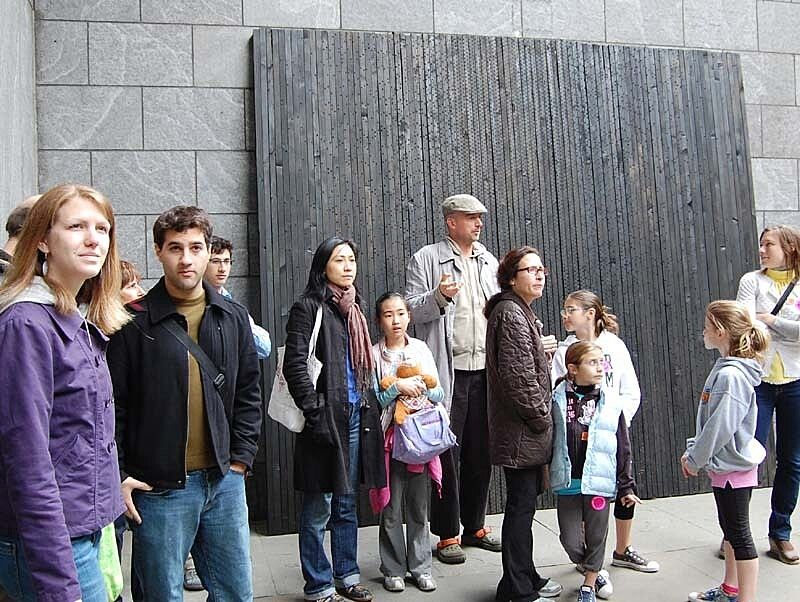 The artist giving a tour to families