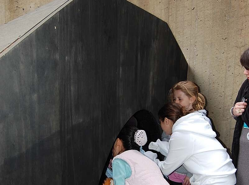 Kids interacting with an art display