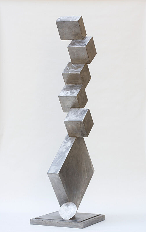 A steel sculpture of cubic shapes stacked on top of each other.