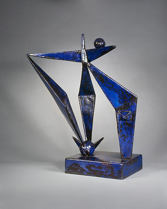 A steel sculpture of angular shapes.