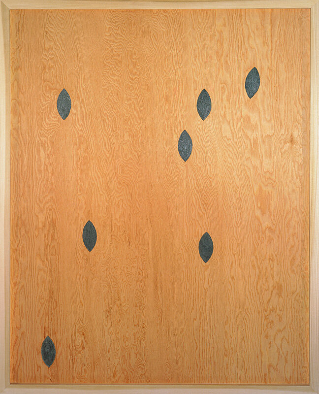 A painting of almond shapes on wood.