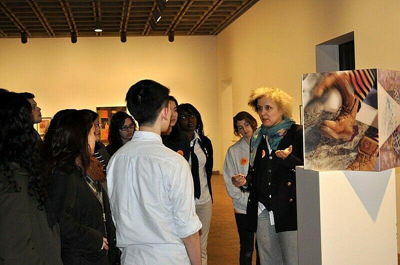 artist standing in front of her art installation