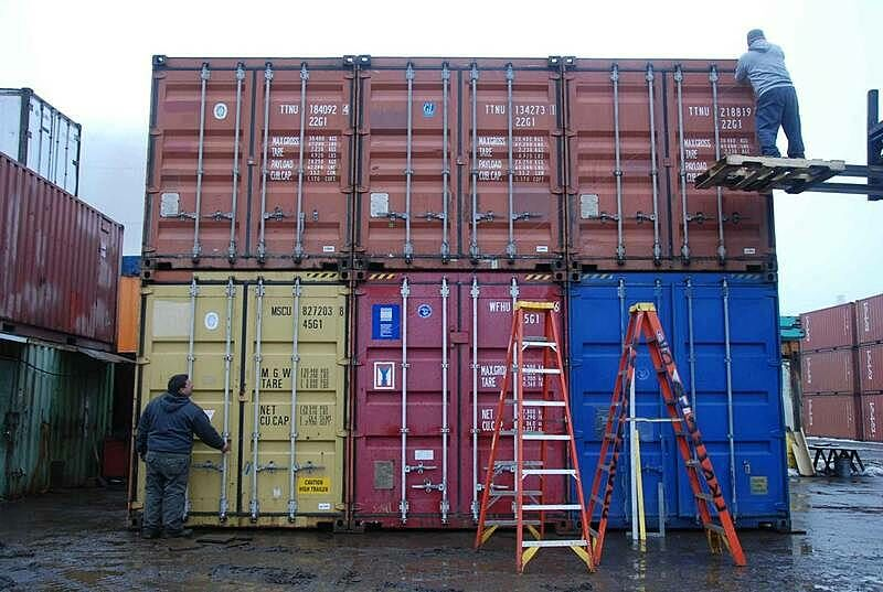 Shipping containers stacked together