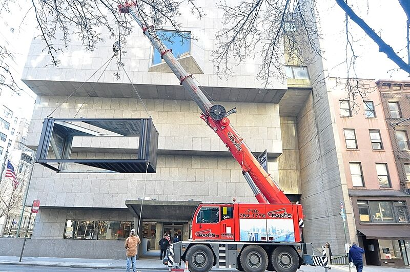 A crane hoisting a shipping container