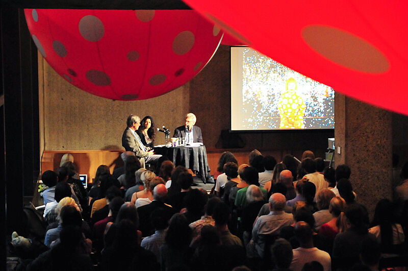 A panel discussion in front of a live audience.