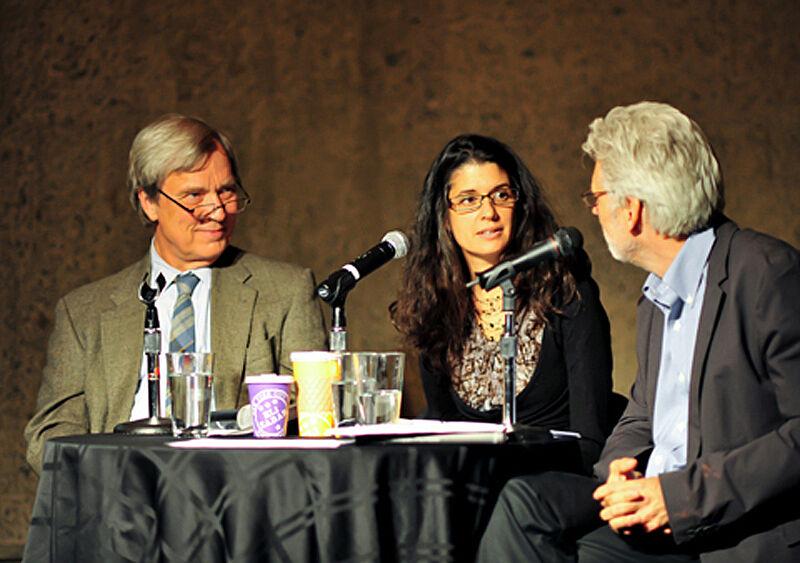 The three panelists talk into microphones.