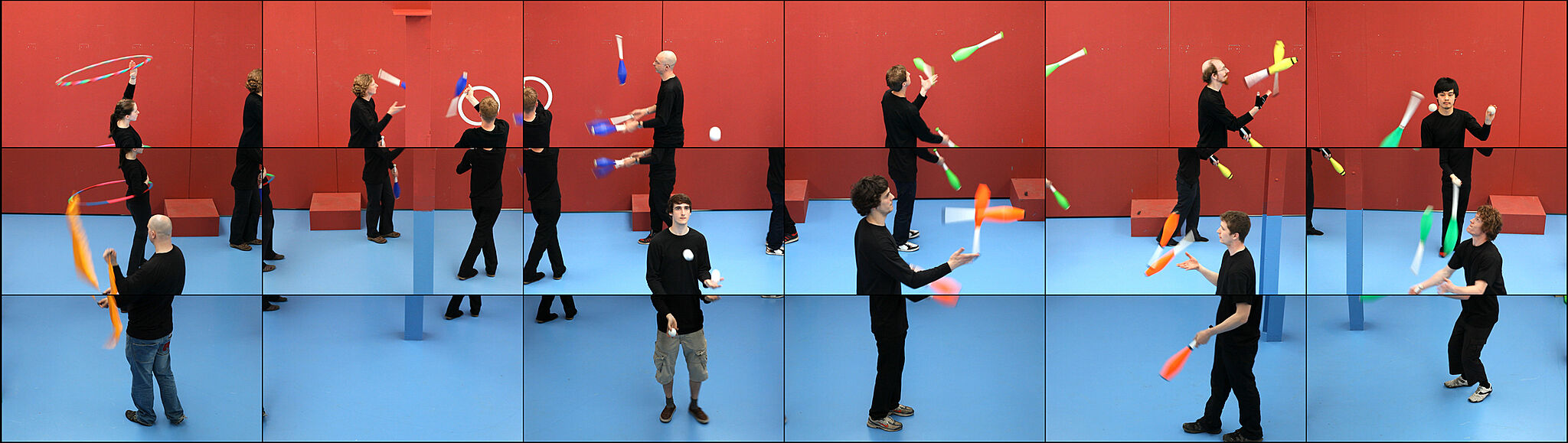 A still from David Hockney's panoramic installation depicting jugglers against a red and blue backdrop.