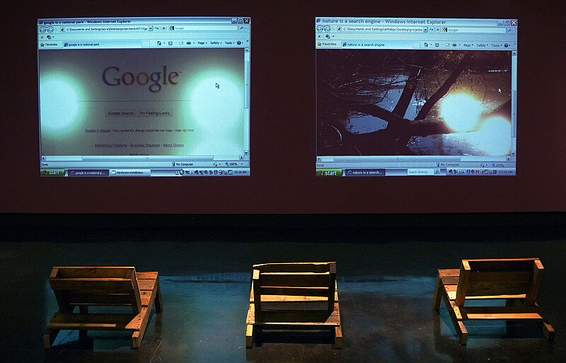 Chairs set up in front of two screens.