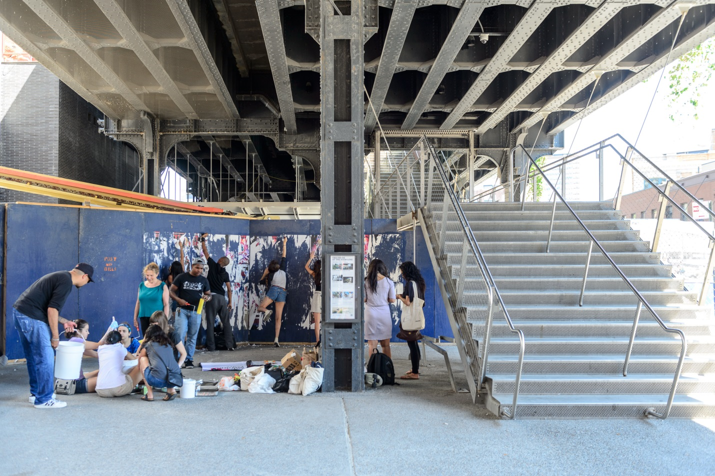 Students putting up posters near the High Line