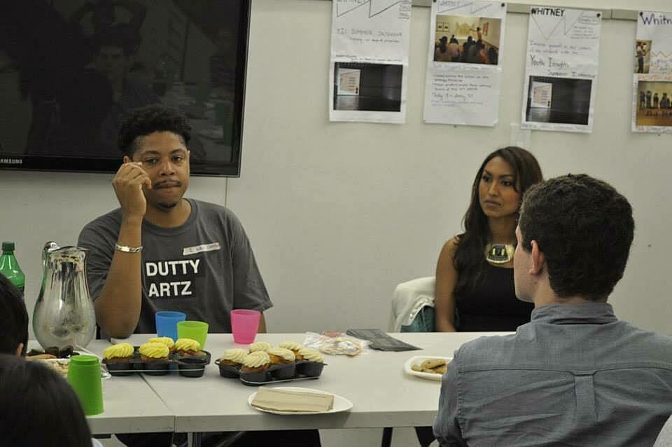 Alumni talk to participants over refreshments.