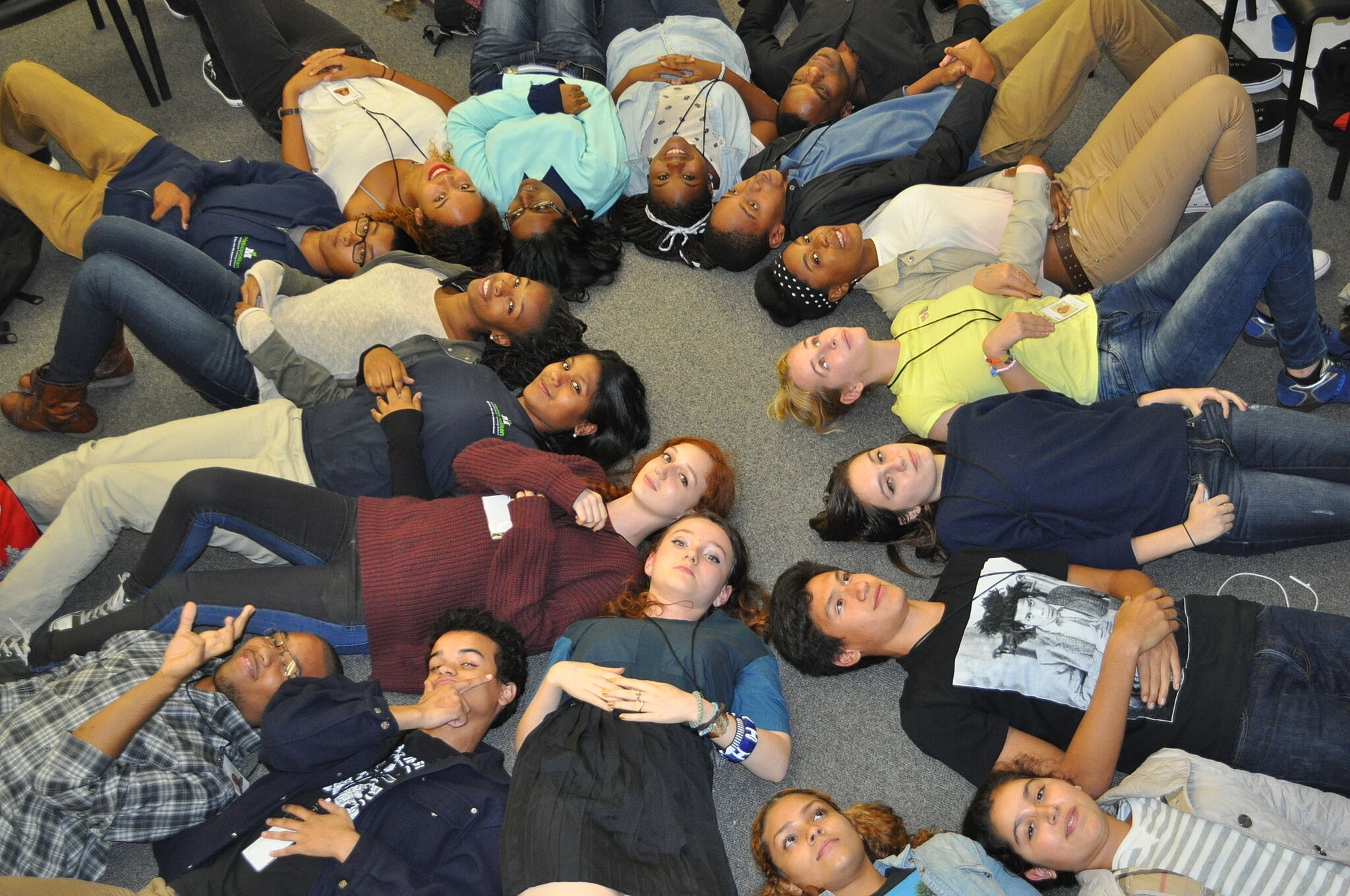 students laying on the floor reflecting on class