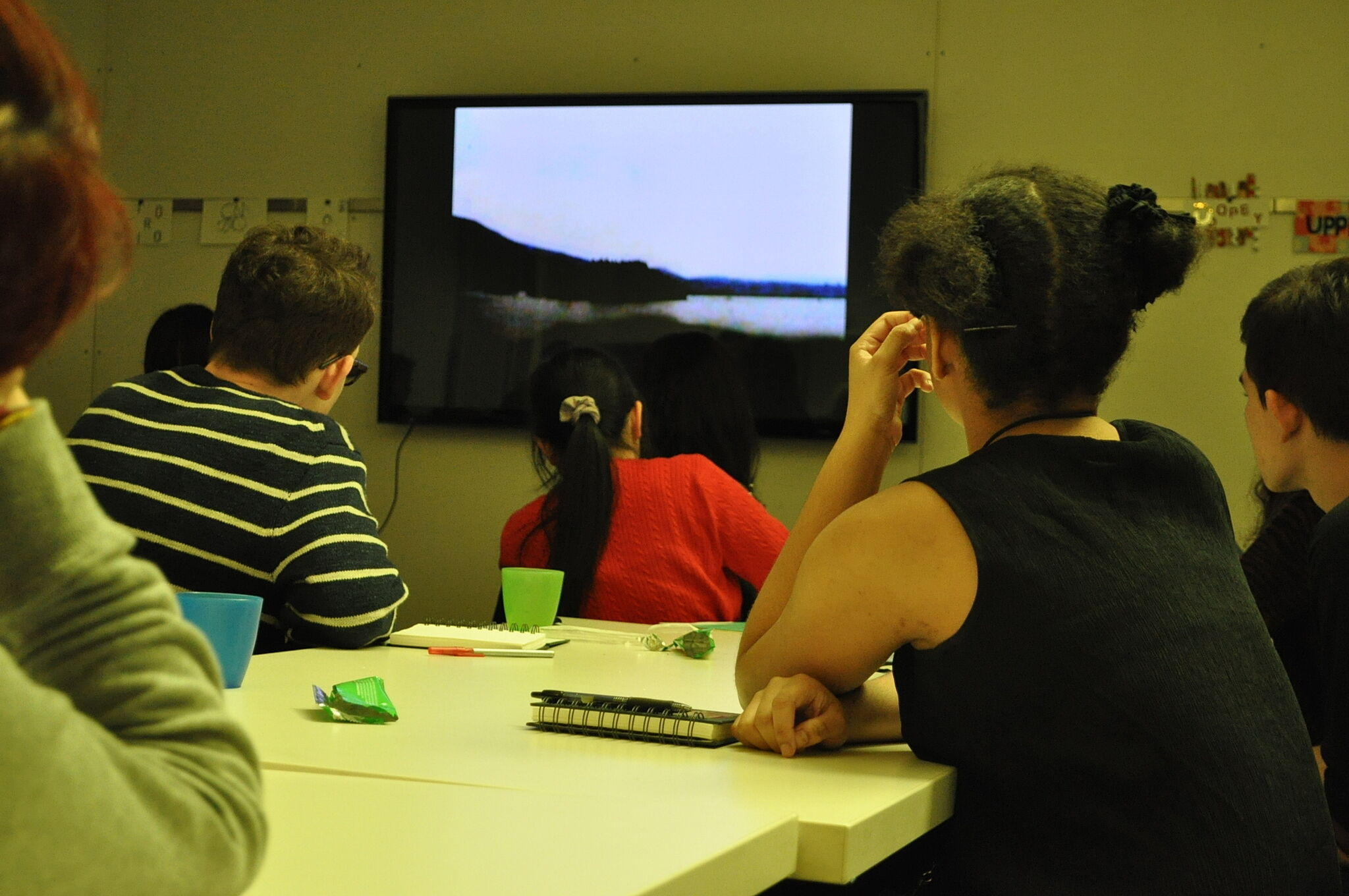 students watching a film in classroom