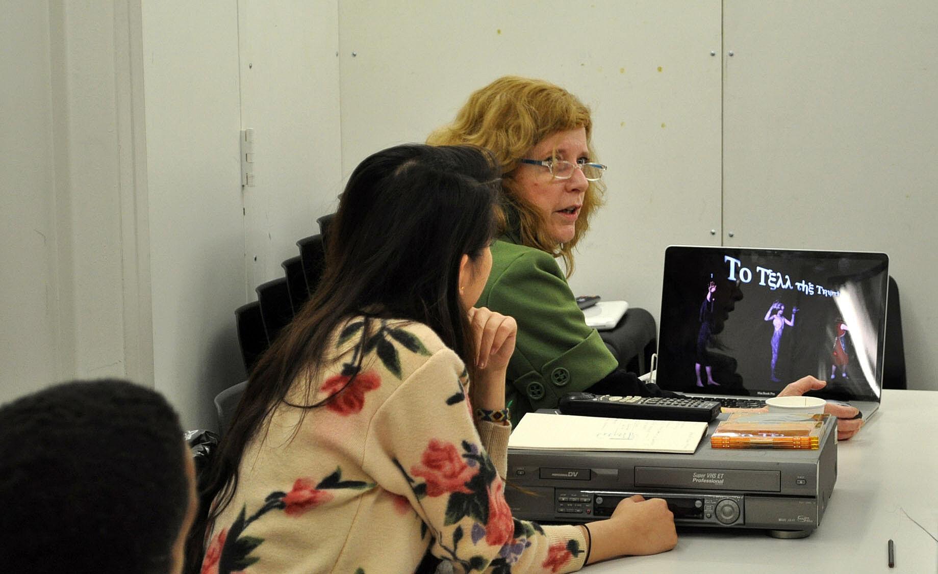 teacher showing her work from a laptop