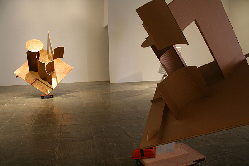 Abstract shape sculptures in a gallery.