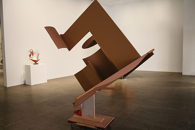 An abstract shaped sculpture at an angle.